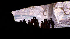 Children stand silhouetted in a cave in Mali, Africa. Stock Footage