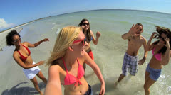 Young College Friends Posting Vacation Beach Party Fun Stock Footage