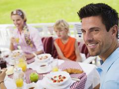 family at breakfast table - stock photo