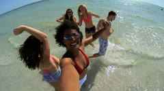 Multi Ethnic Teenagers Filming Fun Beach Time Together Stock Footage