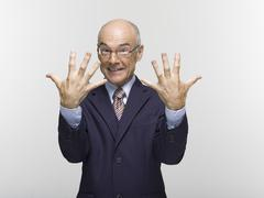 businesman making hand gesture, portrait - stock photo