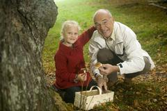 germany, baden-württemberg, swabian mountains, grandfather and granddaughter - stock photo