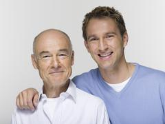 Stock Photo of Father and adult son, portrait