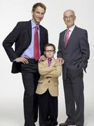 Grandson (8-9) grandfather and son wearing business cloth, portrait - stock photo
