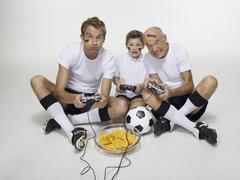 German soccer fans, playing video game, portrait Stock Photos