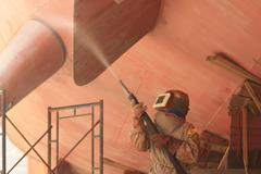Stock Photo of sandblasting of metal structures at construction site