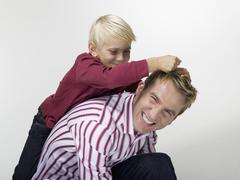 Portrait, Father and son (8-9), close-up - stock photo