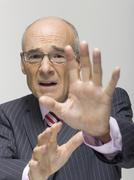 Senior businessman making a stop gesture, portrait - stock photo