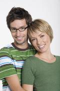 Front view portrait of young couple, smiling - stock photo