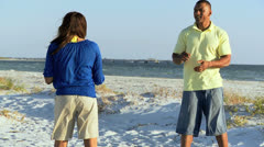 Young Couple Enjoying Leisure  Beach Games Stock Footage