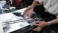 Stock Video Footage of the artist use finger painting a bamboo picture