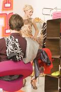 Young couple in the fitting room of a clothing store - stock photo