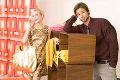 Couple shopping, woman using mobile phone Stock Photos