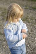 Little girl (3-4) wearing cardigan - stock photo