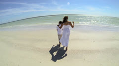 Ethnic Mother Son Beach Shot Wide Angle - stock footage