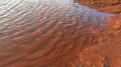 Sediment bowl of rusty water. - stock footage