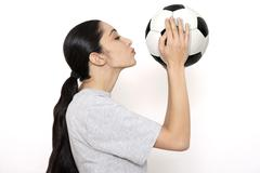 Female soccer fan holding soccer ball,  portrait Stock Photos