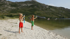 Kids having fun with soap bubbles Stock Footage
