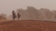 Stock Video Footage of Women walk carrying goods on their heads through the Sahara desert in mali.