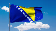 Stock Video Footage of Bosnian flag waving over a blue cloudy sky