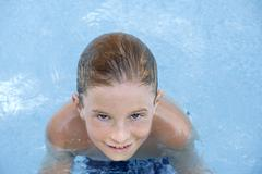 Boy (10-11 in swimming pool, portrait, elevated view Stock Photos