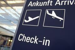 Germany, Bavaria, Munich Airport, Arrival, Check In, decal information Stock Photos