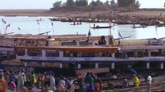 Boats are loaded along the Niger River in mali, Africa. Stock Footage