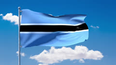 Batswana flag waving over a blue cloudy sky Stock Footage