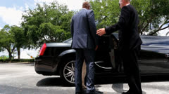International Banking Leaders Being Met Limousine Chauffeur Stock Footage