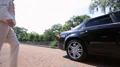 International Banking Leaders Being Met Limousine Chauffeur Stock Footage