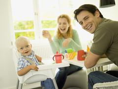 Young family with baby boy, (12-24 months) Stock Photos