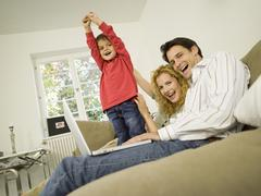 Young family in living room, smiling Stock Photos