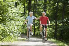 Senior couple biking Stock Photos