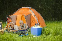 Stock Photo of Senior couple camping, portrait