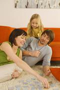 Family playing memory - stock photo