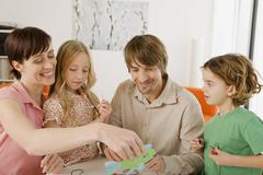 Family doing handicraft, smiling, portrait Stock Photos