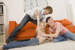 Playful family in living room Stock Photos