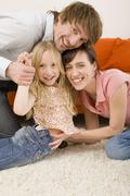 Stock Photo of Playful family in living room, portrait