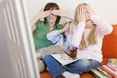 Mother and children covering eyes Stock Photos