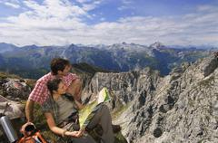 Austria, Salzburger Land, couple on mountain top, portrait Stock Photos