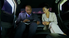 Male Female Business People Being Driven Luxury Limousine Stock Footage