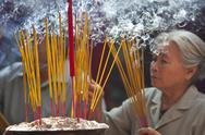 Stock Photo of woman with lit incense sticks