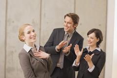 Business people in a meeting, applauding Stock Photos