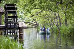 Tourists on boat trip at daio wasabi farm, hokata Stock Photos