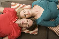 Portrait of a young couple, eyes closed, elevated view - stock photo