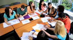 Overhead Ethnic Female Lecturer Working Classroom Teenage Students - stock footage