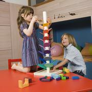 Boy (8-9) and girl (6-7) playing together, portrait - stock photo