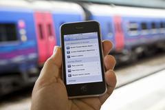 Käyttäen uk juna-aikataulu app Kuvituskuvat