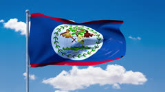Belizean flag waving over a blue cloudy sky Stock Footage