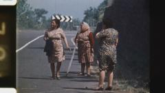 Stock Video Footage of Italian women react to eruption. (Vintage 1970's 16mm film footage).